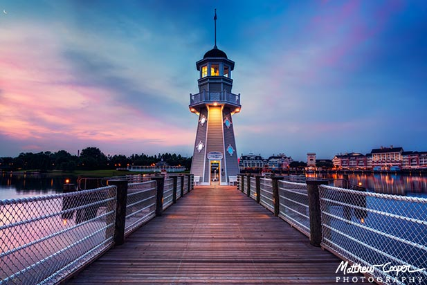 Dawn breaks behind the lighthouse at the Yacht Club Resort