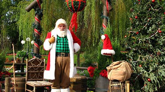 Santa puts on a red coat in Canada in EPCOT