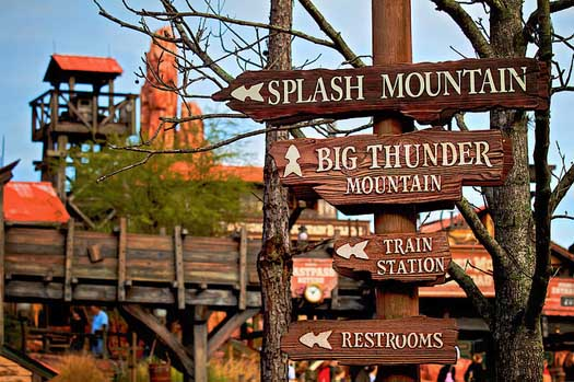 Signs in Frontierland pointing to Splash Mountain Big Thunder Mountain Railroad and the Train Station