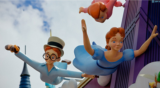 Wendy and the boys flying outside Peter Pan's Flight