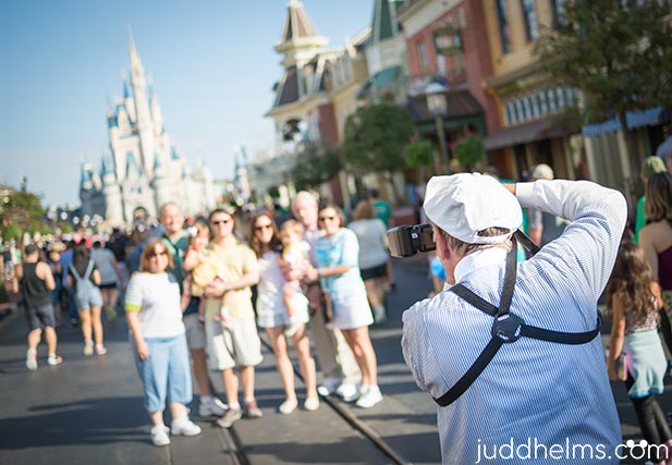 Photopass photographer taking pictures on Main Street